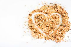 Seasoning for a heart-shaped soup royalty free stock image