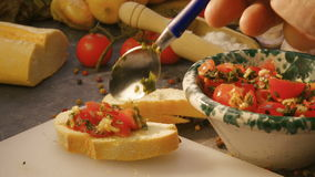 Seasoning italian bruschetta with tomatoes stock video footage