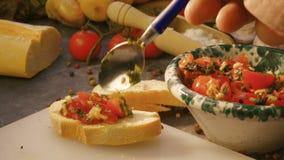 Seasoning italian bruschetta with tomatoes stock video footage
