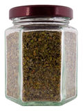 Seasoning marjoram in jar. Stock Photo