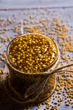 Seasoning from mustard seeds Stock Images