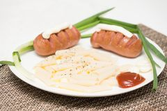 Seasoning rigate with sausages, sauce, mayonnaise and vegetables Royalty Free Stock Image