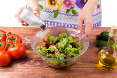 Seasoning of salad. On a table Stock Images