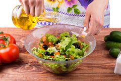 Seasoning of salad. On a table Royalty Free Stock Photography