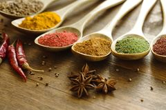 Seasoning. Spices pepper kitchen aphrodisiac wood green stock photos