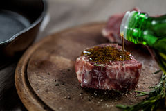 Seasoning steak with olive oil Royalty Free Stock Photos