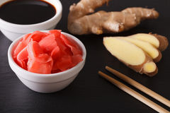 Seasoning for sushi: Soy sauce and pickled ginger close-up. hori Stock Photography