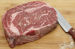 Seasoning wagyu beef with salt Stock Image