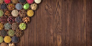 Large set of spices on a wooden table, top view Stock Photos
