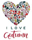Seasons greetings card. Hand drawn lettering autumn with leaves arranged in a heart in fall colors.Seasons greetings card perfect for prints, flyers, banners Vector Illustration