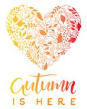 Seasons greetings card. Hand drawn lettering autumn with leaves arranged in a heart in fall colors.Seasons greetings card perfect for prints, flyers, banners Royalty Free Stock Image