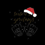 Seasons greetings card with handdrawn mittens and Santa Claus Hat Royalty Free Stock Photos
