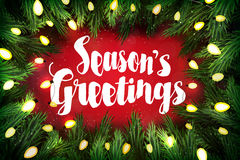 Seasons greetings Christmas greeting card with pine wreath Royalty Free Stock Photography