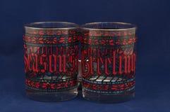 Seasons Greetings Glasses. Vintage highball glasses, holiday seasons greetings glasses Royalty Free Stock Photo