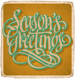 SEASONS GREETINGS hand lettering vintage card (vector) Stock Images