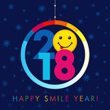 2018 seasons greetings happy smile year card. Christmas ball consisting of colored vector 2018 numbers, text Happy Smile Year and and smile with tongue on snow Royalty Free Stock Photo