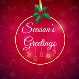 Seasons greetings. Holiday background. Xmas greeting card with bauble. Poster. Stock Photography