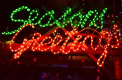 Seasons Greetings. Lit Christmas decoration over archway Stock Photography