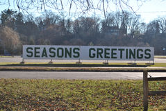Seasons Greetings Sign. In the park Royalty Free Stock Photo