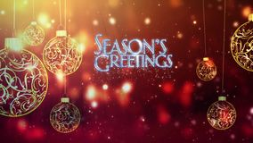 Seasons Greetings Swinging Ornaments in Gold stock footage