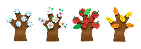4 seasons, winter, spring, summer, autumn tree of bright felt. Craft homemade trees for children royalty free stock photography