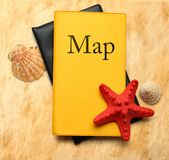 Seastar and seashells with map Royalty Free Stock Photos