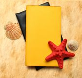 Seastar and seashells with notebook Royalty Free Stock Photography