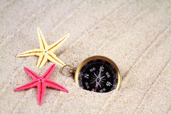 Seastars and compass Stock Image