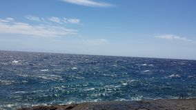Seasun bleu, mer bleue et plage Image libre de droits