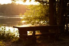 Seat. Picnic seat with table on riverside Stock Image