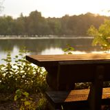 Seat. Picnic seat with table on riverside Royalty Free Stock Photos