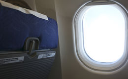 Seat and airplane window Royalty Free Stock Photography