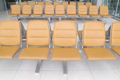 Seat in airport terminal Stock Photos