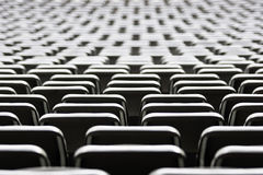 Seat backs at a stadium Stock Photo