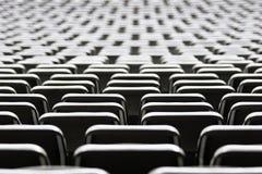 Seat backs at a stadium Stock Photo