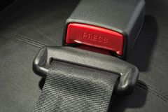 Seat belt. On black leather seat Royalty Free Stock Photo