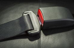 Seat belt. On black leather seat Stock Photography