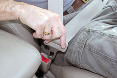 Locking a car seat belt for safety Royalty Free Stock Photo