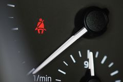 Seat belt icon on car dashboard stock photos