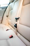 Seat belt on rear seat of modern car with beige leather interior Royalty Free Stock Image
