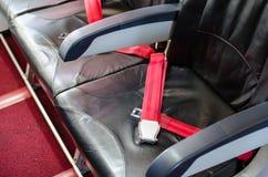 Seat belt on seat shot in airplane Stock Photo