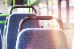 Seat in the bus. Seat places in front side with broken handle Stock Photos