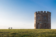 Seat and castle in green field Stock Photography