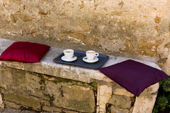 Seat with coffee pots in Croatia. Stone seat with coffee pots in Croatia Stock Images
