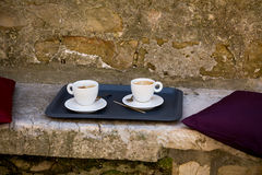 Seat with coffee pots in Croatia. Stone seat with coffee pots in Croatia, closeup Stock Images