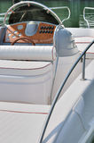 Seat and control panel of a boat. Control panel and seat of a boat, shown as entertainment, holiday or marine activity Royalty Free Stock Image