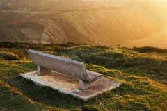 Seat en la puesta del sol imagenes de archivo