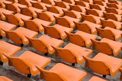 Seat grandstand orange watch the games inside the stadium. Stock Image