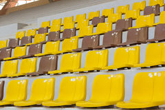 Seat grandstand yellow brown Stock Images
