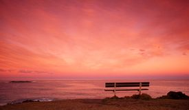 Seat on the headland. Overlooking the ocean, at sunset Royalty Free Stock Images